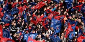 Paris Saint-Germain's supporters wave flags during the French L1 football match between Paris Saint-Germain (PSG) vs Toulouse on February 21, 2015 at the Parc des Princes stadium in Paris. AFP PHOTO / FRANCK FIFE